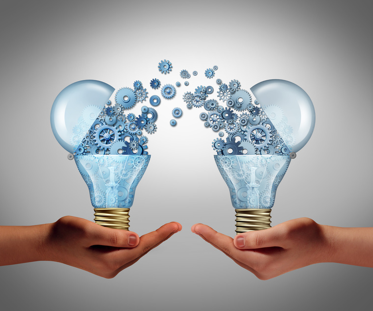 Ideas agreement Investing in business innovation concept and financial commerce backing of creativity as an open lightbulb symbol for funding potential innovative growth prospect through venture capital.